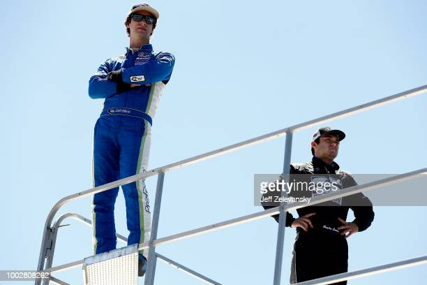 Josh Bilicki driver of the Prevagen Toyota and Bayley Currey stand atop a hauler during practice for the NASCAR Xfinity Series Lakes Region 200 at...