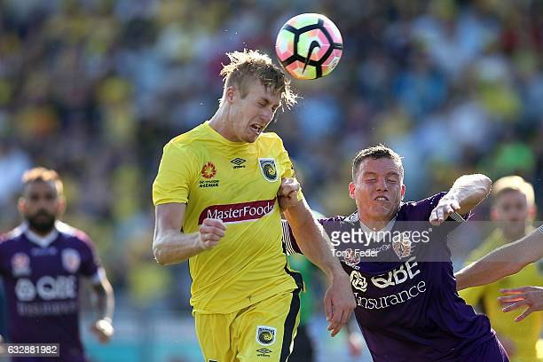 Josh Bingham of the Mariners contests a header with Shane Lowry of the Glory during the round 17 ALeague match between the Central Coast Mariners and...