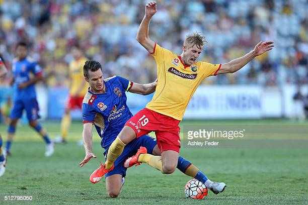 Josh Bingham of the Mariners contests the ball against Nigel Boogaard of the Jets during the round 21 ALeague match between the Central Coast...