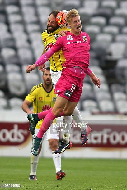 Josh Bingham of the Mariners contests the ball with his Phoenix opponent during the round five A-League match between the Central Coast Mariners and...