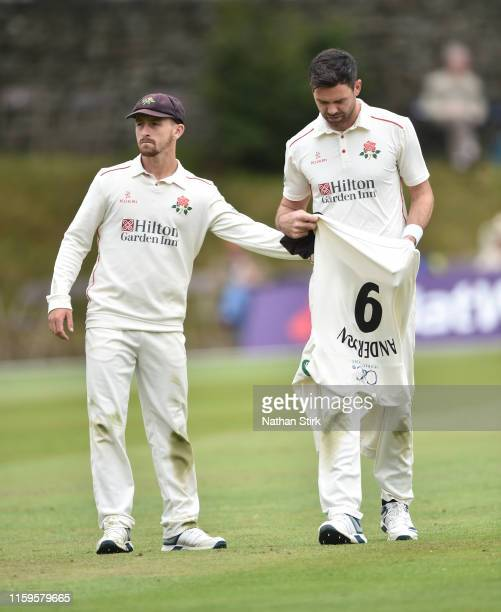 Josh Bohannon looks on as James Anderson of Lancashire walks off injured during the Specsavers County Championship Division Two match between...