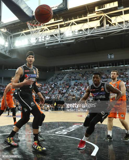 Josh Boone and Carrick Felix of Melbourne United watch as the ball heads out of play during the round 14 NBL match between Melbourne United and the...