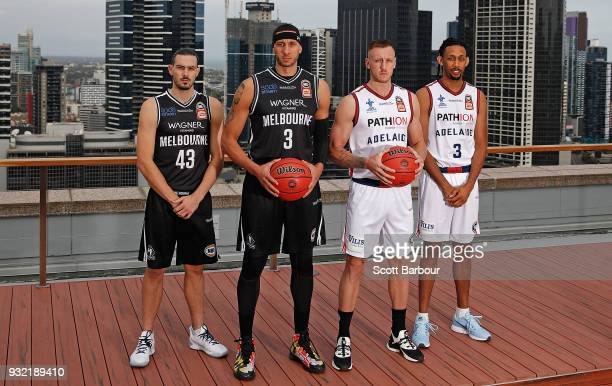 Josh Boone and Chris Goulding of Melbourne United along with Mitch Creek and Josh Childress of the Adelaide 36ers pose with the Dr John Raschke...