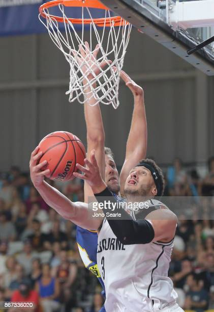 Josh Boone of Melbourne lays the ball up during the round four NBL match between the Brisbane Bullets and Melbourne United at Carrara Stadium on...