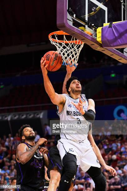 Josh Boone of Melbourne lays up a shot under pressure during the round 12 NBL match between the Sydney Kings and Melbourne United at Qudos Bank Arena...