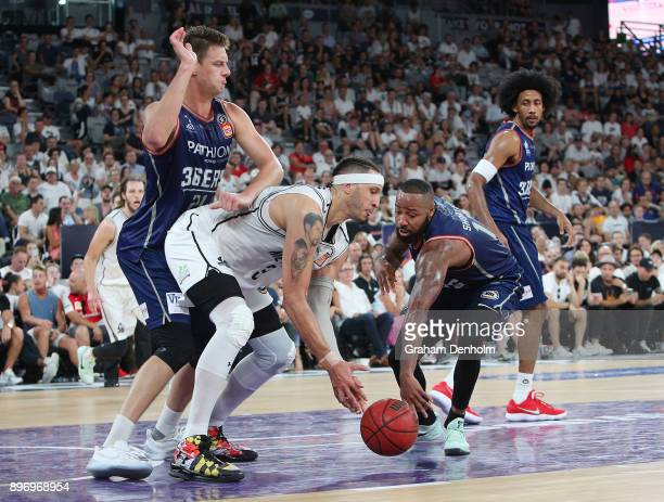 Josh Boone of Melbourne United competes for the ball with Shannon Shorter of the Adelaide 36ers during the round 11 NBL match between Melbourne...