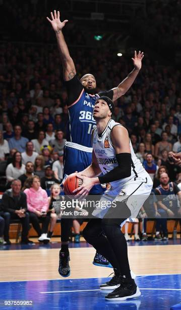 Josh Boone of Melbourne United defended by Shannon Shorter of the Adelaide 36ers during game four of the NBL Grand Final series between the Adelaide...