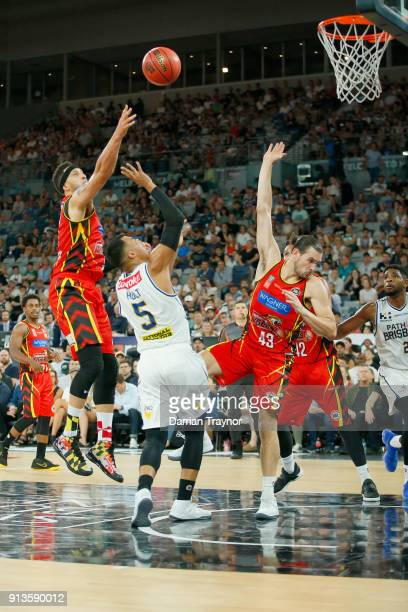 Josh Boone of Melbourne United defends Stephen Holt of the Brisbane Bullets during the round 17 NBL match between Melbourne United and the Brisbane...