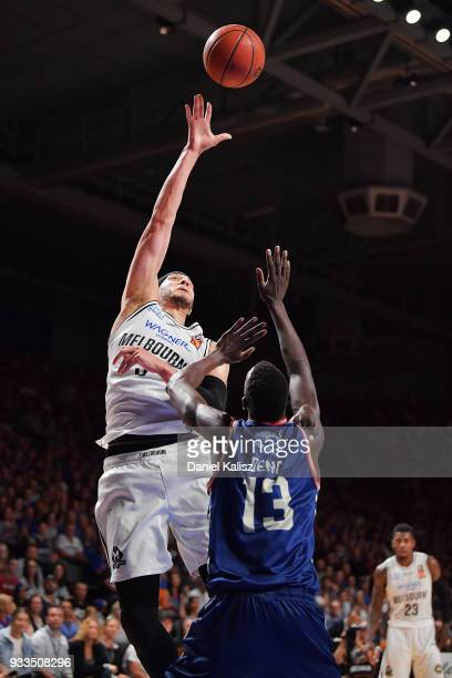 Josh Boone of Melbourne United shoots over Majok Deng of the Adelaide 36ers during game two of the NBL Grand Final series between the Adelaide 36ers...