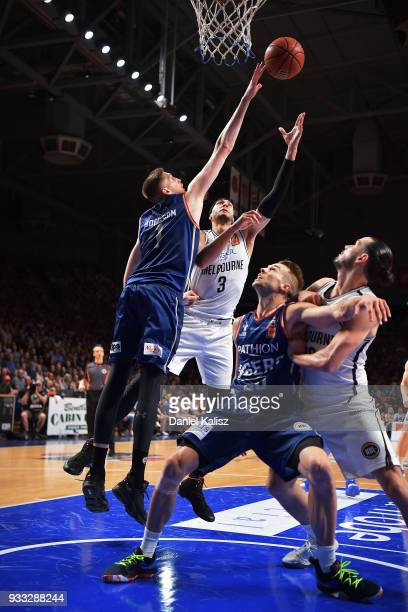 Josh Boone of Melbourne United shoots over Matthew Hodgson of the Adelaide 36ers during game two of the NBL Grand Final series between the Adelaide...