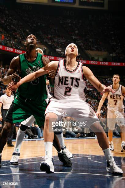 Josh Boone of the New Jersey Nets boxes out Kevin Garnett of the Boston Celtics on January 11 2008 at the IZOD Center in East Rutherford New Jersey...