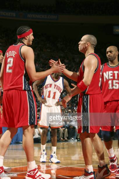 Josh Boone of the New Jersey Nets highfives teammate Jason Kidd against the New York Knicks on January 19 2007 at Madison Square Garden in New York...