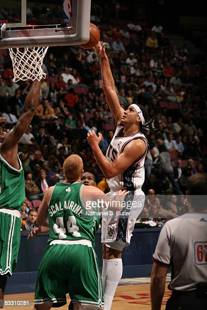 e39890f0b2a Josh Boone of the New Jersey Nets shoots against Brian Scalabrine of the  Boston Celtics on