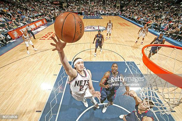 Josh Boone of the New Jersey Nets shoots against Joe Smith and Wally Szczerbiak the Cleveland Cavaliers on March 12 2008 at the Izod Center in East...