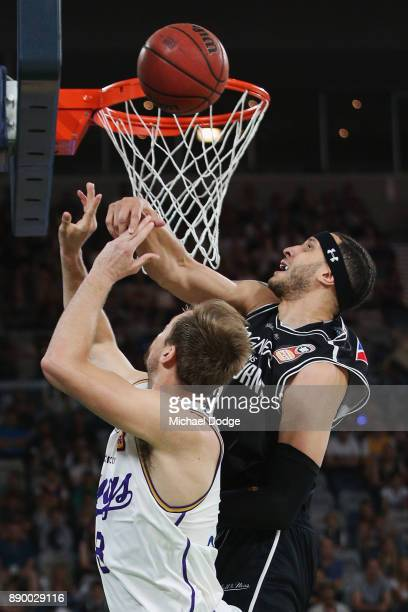 Josh Boone of United blocks Brad Newley of the Kings during the round nine NBL match between Melbourne United and the Sydney Kings at Hisense Arena...