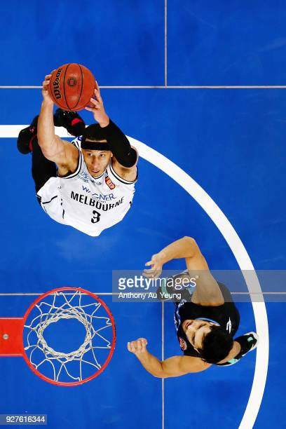 Josh Boone of United goes up against Shea Ili of the Breakers during game two of the NBL semi final series between Melbourne United and the New...