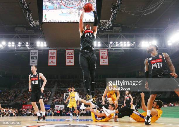 Josh Boone of United pulls in a rebound over Andrew Bogut of the Kings during the round four NBL match between Melbourne United and the Sydney Kings...