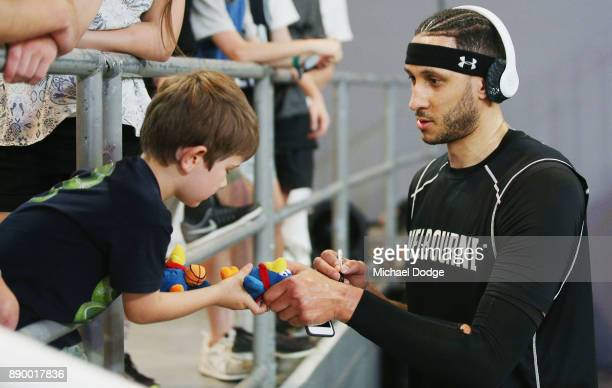 Josh Boone of United signs autographs for fans during the round nine NBL match between Melbourne United and the Sydney Kings at Hisense Arena on...
