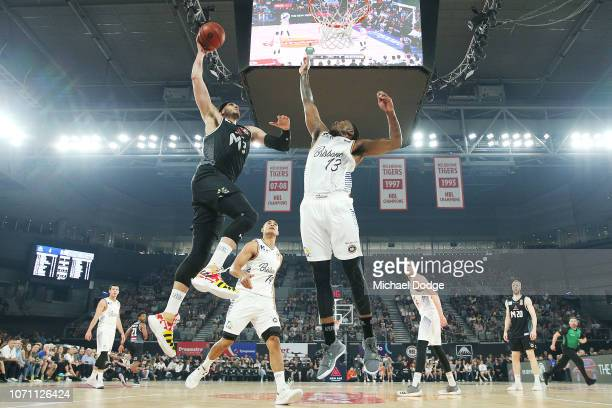 Josh Boone of United slam dunks against Lamar Harrison of the Bullets during the round eight NBL match between Melbourne United and the Brisbane...