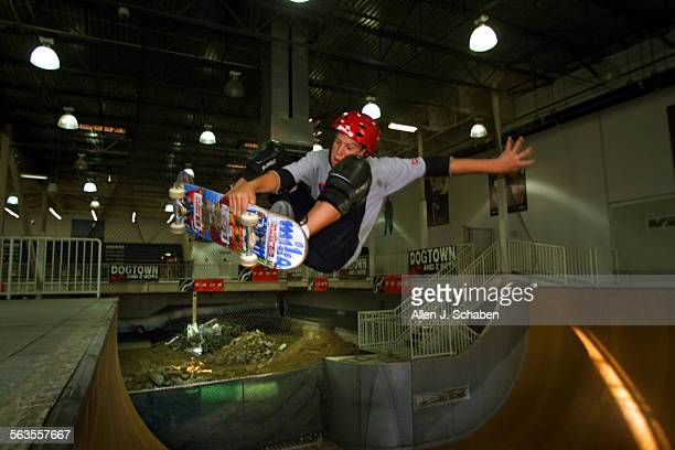 Josh Borden of Orange goes airborne off the 12–foot vert ramp Wednesday as rubble lies from the old skate pool in the background making way for a...