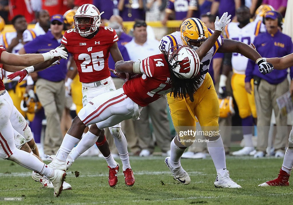 Josh Boutte #76 of the LSU Tigers delivers a late hit against D'Cota Dixon #14 of the Wisconsin Badgers after Dixon intercepted a pass during the fourth quarter at Lambeau Field on September 3, 2016 in Green Bay, Wisconsin. Boutte was disqualified from the game.