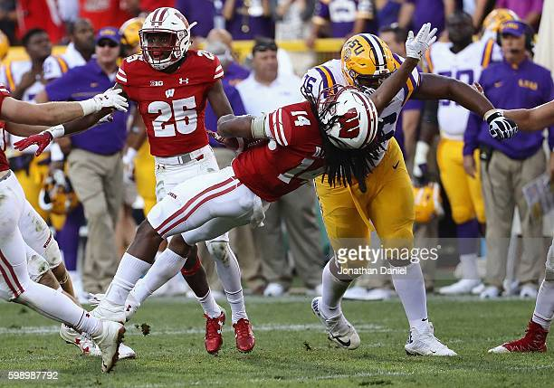 Josh Boutte of the LSU Tigers delivers a late hit against D'Cota Dixon of the Wisconsin Badgers after Dixon intercepted a pass during the fourth...