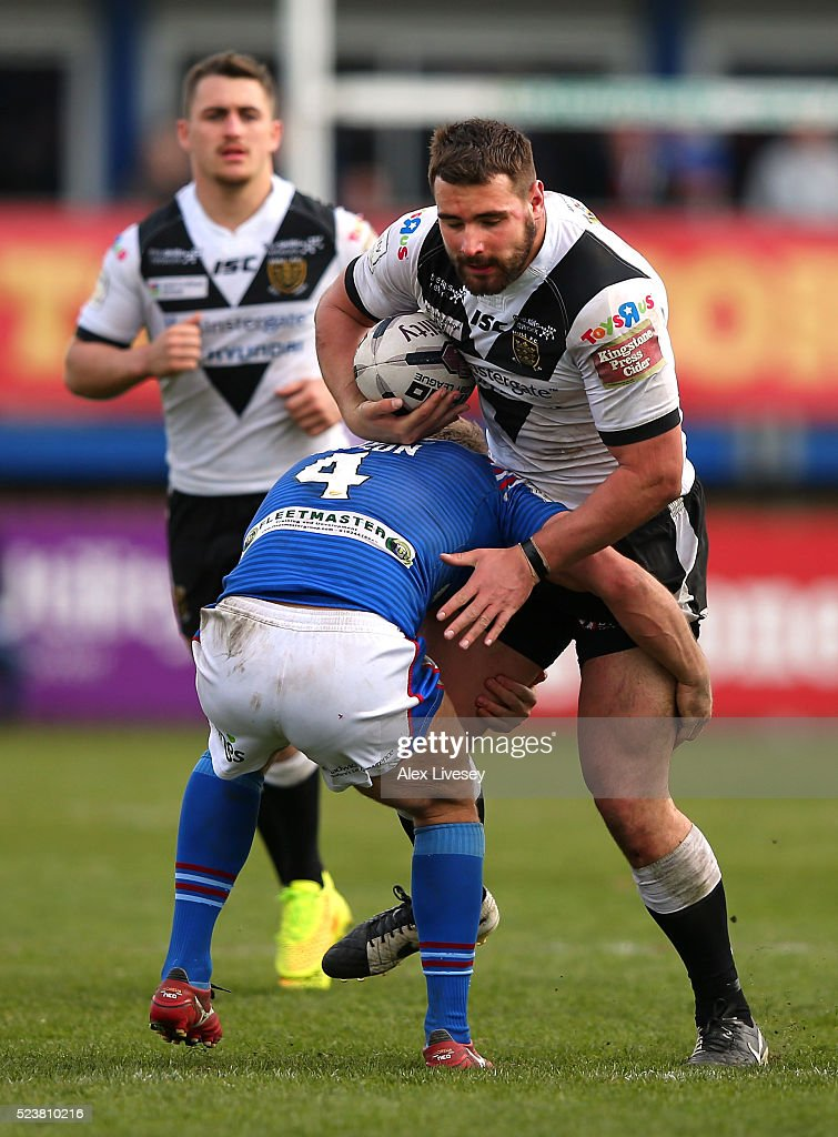 Josh Bowden of Hull FC is tackled by Ashley Gibson of Wakefield Wildcats during the First Utility Super League match between Wakefield Wildcats and Hull FC at The Rapid Solicitors Stadium on April 24, 2016 in Wakefield, England.