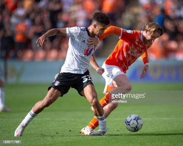 Josh Bowler of Blackpool and Antonee Robinson of Fulham in action during the Sky Bet Championship match between Blackpool and Fulham at Bloomfield...
