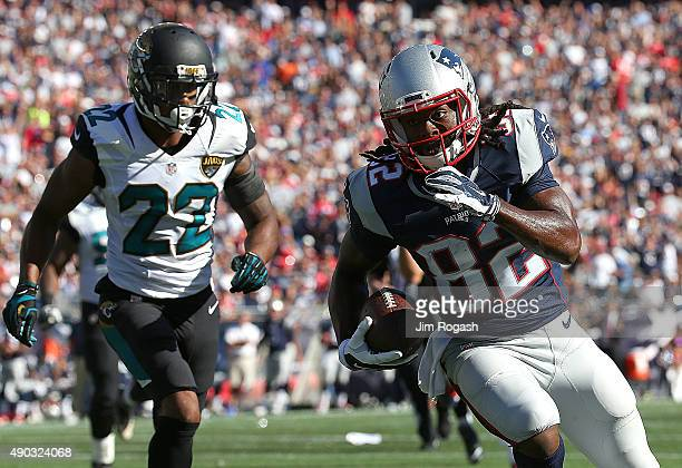 Josh Boyce of the New England Patriots runs the ball into the end zone for the touchdown by Aaron Colvin of the Jacksonville Jaguars in the third...