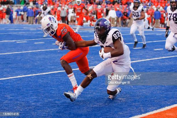 Josh Boyce of the TCU Horned Frogs pulls away from Quaylon Ewing-Burton of the Boise State Broncos to score a two point conversion against the Boise...