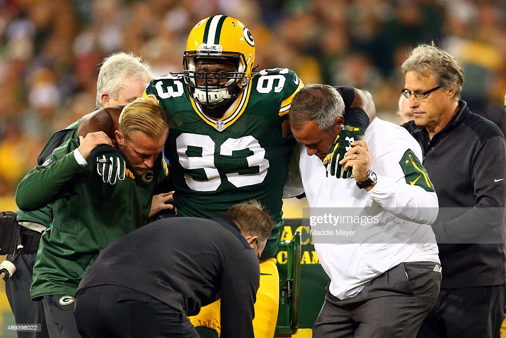 Josh Boyd #93 of the Green Bay Packers gets assisted off the field after being injured in a play against the Seattle Seahawks during their game at Lambeau Field on September 20, 2015 in Green Bay, Wisconsin.