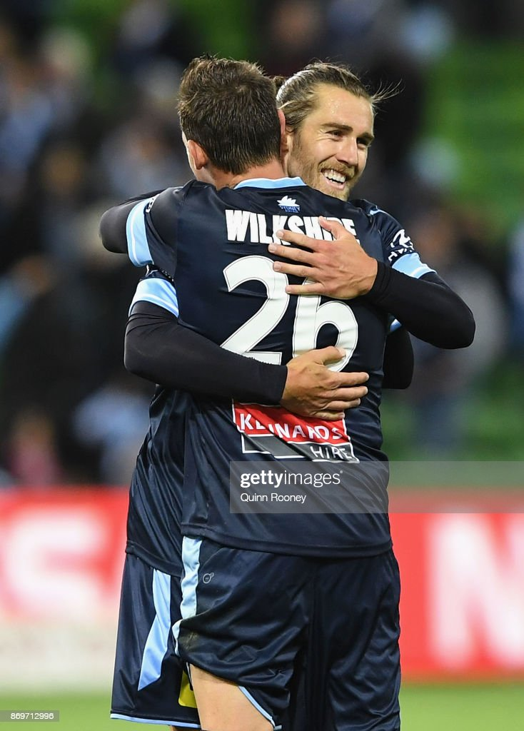 Josh Brillante and Luke Wilkshire of Sydney FC celebrate winning the round five A-League match between Melbourne City FC and Sydney FC at AAMI Park on November 3, 2017 in Melbourne, Australia.