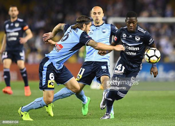 Josh Brillante of Sydney FC and Leroy George of the Victory compete for the ball during the round one ALeague match between the Melbourne Victory and...