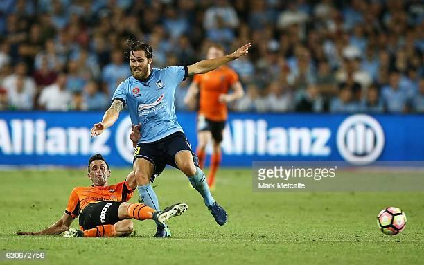 Josh Brilliante of Sydney FC is tackled by Arana of the Roar during the round 13 ALeague match between Sydney FC and Brisbane Roar at Allianz Stadium...