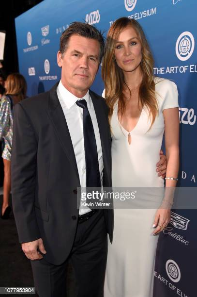 Josh Brolin and Kathryn Boyd attend Michael Muller's HEAVEN presented by The Art of Elysium on January 5 2019 in Los Angeles California