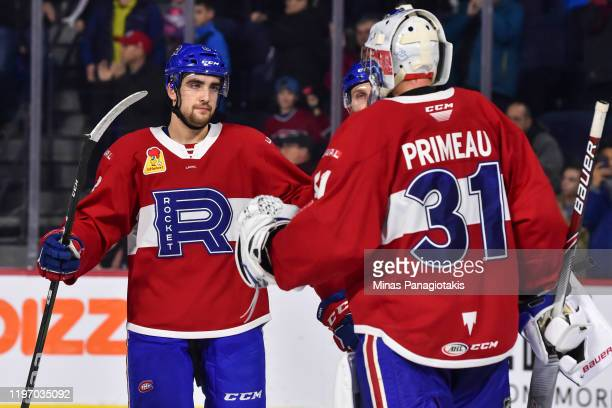 Josh Brook of the Laval Rocket and goaltender Cayden Primeau celebrate a victory against the Toronto Marlies at Place Bell on December 28 2019 in...