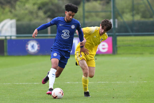 Josh Brooking of Chelsea runs with the ball during the U18 Premier League match between Chelsea and Fulham at Chelsea Training Ground on May 15, 2021...