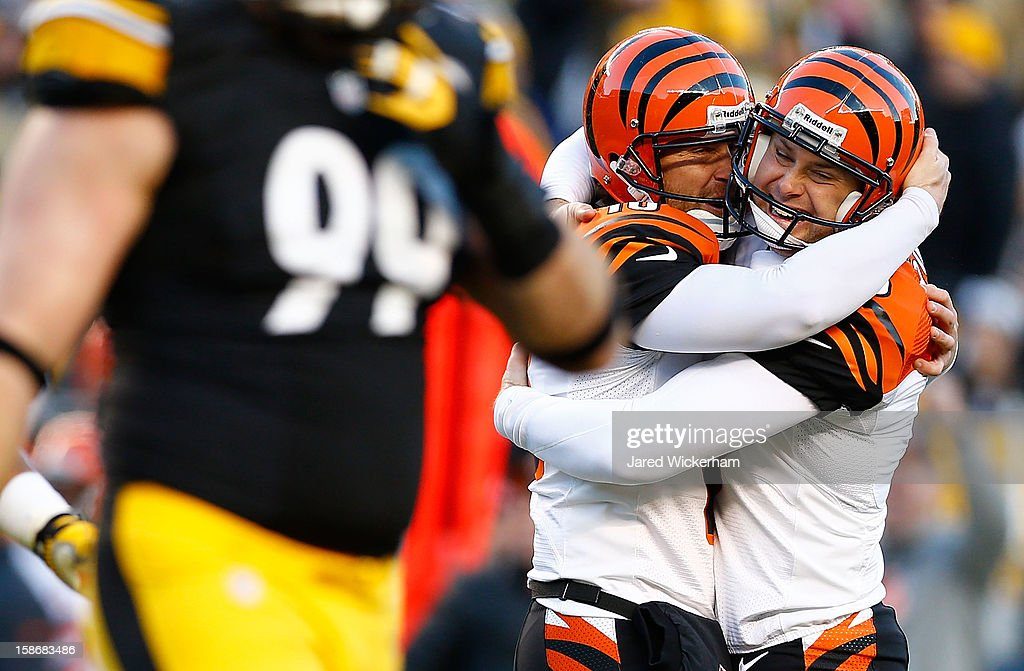 Josh Brown #3 celebrates with teammate Kevin Huber #10 of the Cincinnati Bengals after kicking the game winning field goal in the final seconds of the fourth quarter against the Pittsburgh Steelers during the game at Heinz Field on December 23, 2012 in Pittsburgh, Pennsylvania.