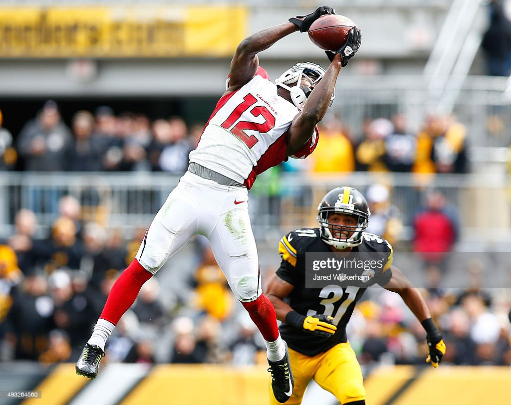 Josh Brown #12 of the Arizona Cardinals catches a pass in front of Ross Cockrell #31 of the Pittsburgh Steelers in the second half during the game at Heinz Field on October 18, 2015 in Pittsburgh, Pennsylvania.