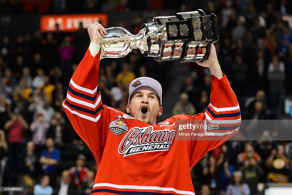 Josh Brown #3 of the Oshawa Generals hoists the Memorial Cup in the air after defeating the Kelowna Rockets during the 2015 Memorial Cup Championship at the Pepsi Coliseum on May 31, 2015 in Quebec City, Quebec, Canada. The Oshawa Generals defeated the Kelowna Rockets 2-1 in overtime and become the 2015 Memorial Cup Champions.