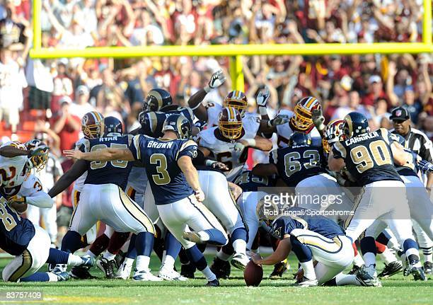 Josh Brown of the St. Louis Rams kicks a game winning 49 yard field goal against the Washington Redskins at FedEx Field on October 12, 2008 in...