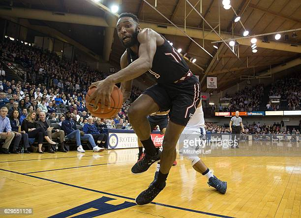 Josh Brown of the Temple Owls tries to save the ball from going out of bounds against the Villanova Wildcats in the first half at The Pavilion on...