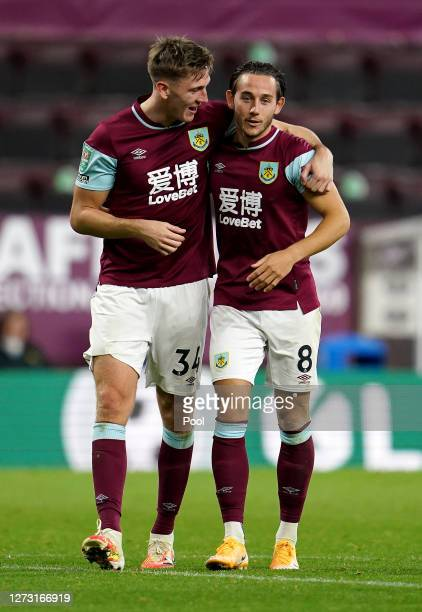 Josh Brownhill and Jimmy Dunne of Burnley celebrate following the Carabao Cup second round match between Burnley and Sheffield United at Turf Moor on...
