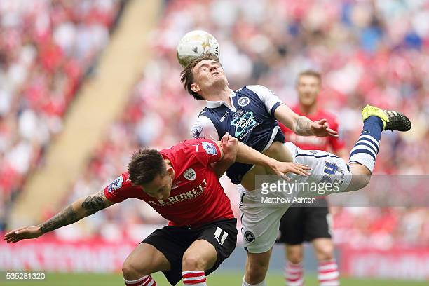 Josh Brownhill of Barnsley and Ben Thompson of Millwall during the Sky Bet League One Play Off Final between Barnsley and Millwall at Wembley Stadium...