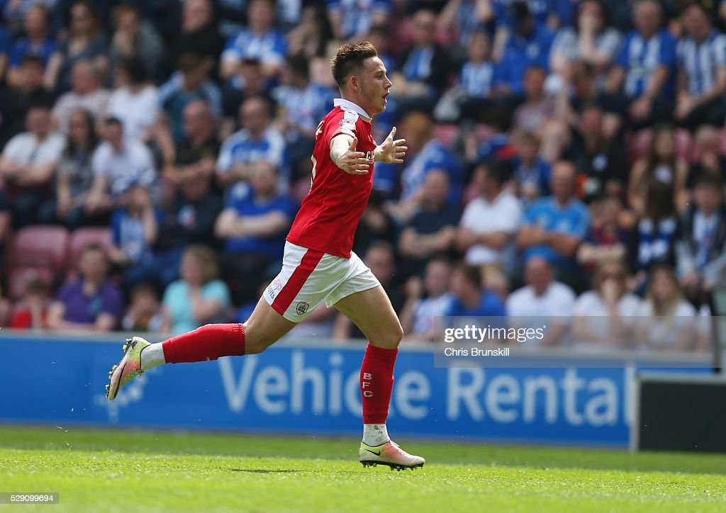 Josh Brownhill of Barnsley celebrates as he scores their fourth goal from a free kick during the Sky Bet League One match between Wigan Athletic and Barnsley at DW Stadium on May 8, 2016 in Wigan, England.
