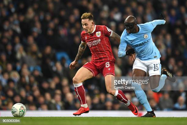 Josh Brownhill of Bristol City and Eliaquim Mangala of Manchester City chase the ball during the Carabao Cup SemiFinal First Leg match between...