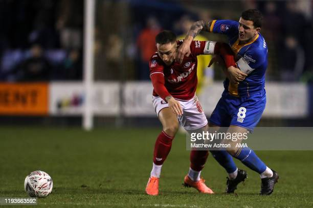 Josh Brownhill of Bristol City and Oliver Norburn of Shrewsbury Town during the FA Cup Third Round Replay match between Shrewsbury Town and Bristol...