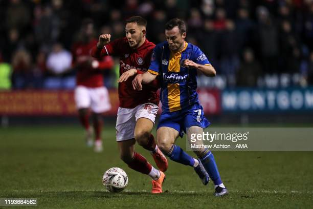 Josh Brownhill of Bristol City and Shaun Whalley of Shrewsbury Town during the FA Cup Third Round Replay match between Shrewsbury Town and Bristol...