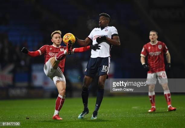 Josh Brownhill of Bristol City battles for the ball with Sammy Ameobi of Bolton Wanderers during the Sky Bet Championship match between Bolton...