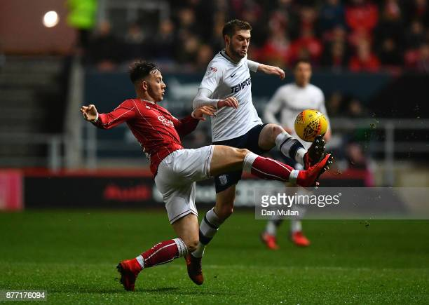 Josh Brownhill of Bristol City battles for the ball with Tom Barkhuizen of Preston North End during the Sky Bet Championship match between Bristol...